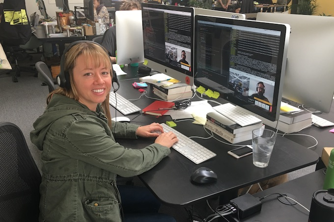 Krista Nelson working on a distributed team in office